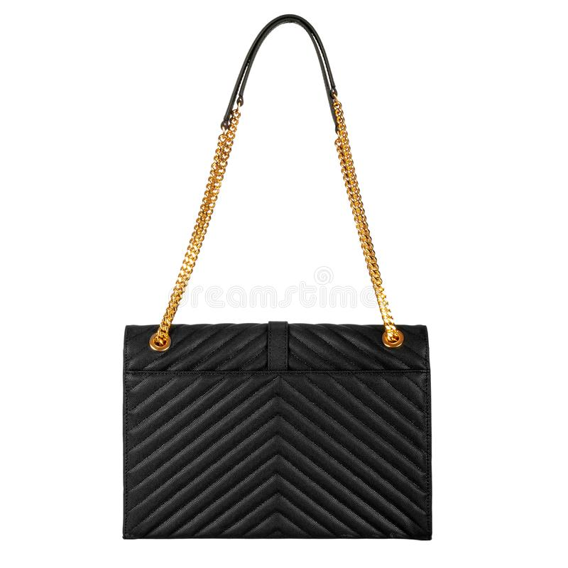 Leather black female bag with gold large chain. Leather black female bag with diagonal embossing and gold large chain stock photos