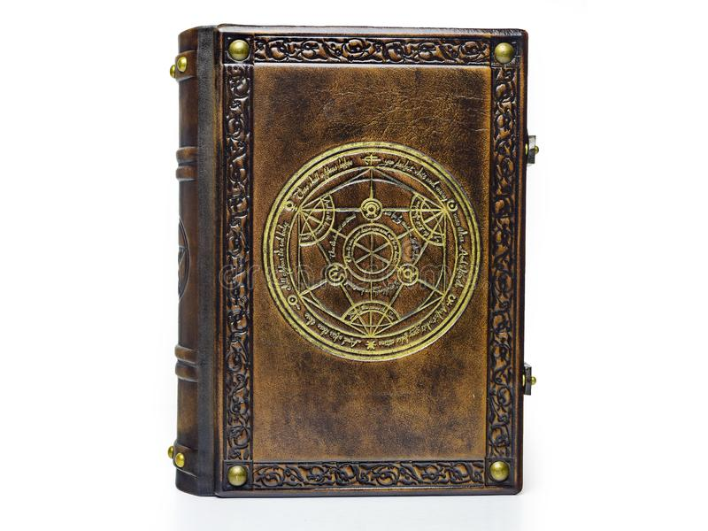 Leather book with gilded transmutation circle in center of the front cover, attributed to a German alchemist from the 17th century. Captured frontal and stock photo