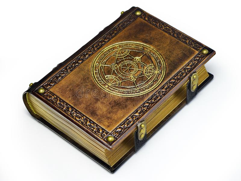 Leather book with gilded transmutation circle in center of the front cover, attributed to a German alchemist from the 17th century. Captured isolated while stock image