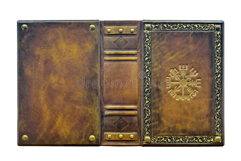 Leather book with the Vegvisir, ancient Icelandic magical symbol. royalty free stock images