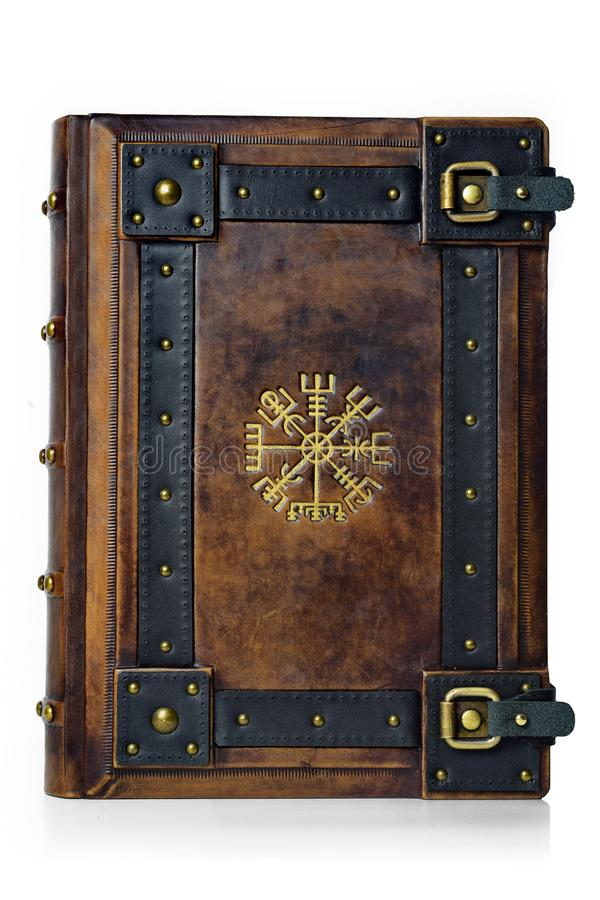 Leather bound book with gilded ancient Viking symbol - front view of the front cover. stock photos