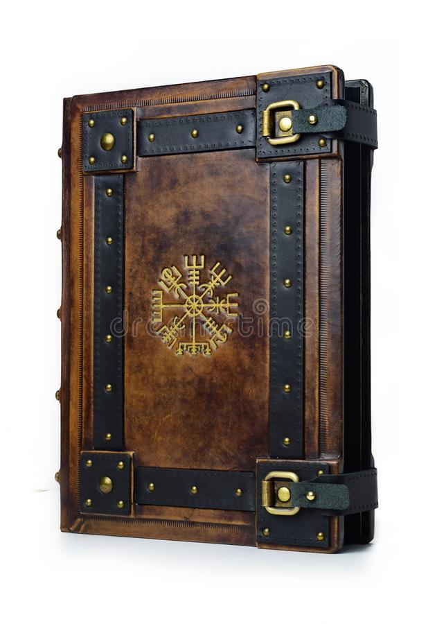 Leather bound book with gilded ancient Viking symbol - view from the right side of the front cover stock images