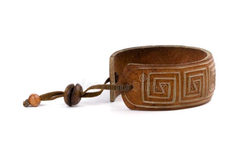 Leather bracelet. Isolated on white background royalty free stock photos