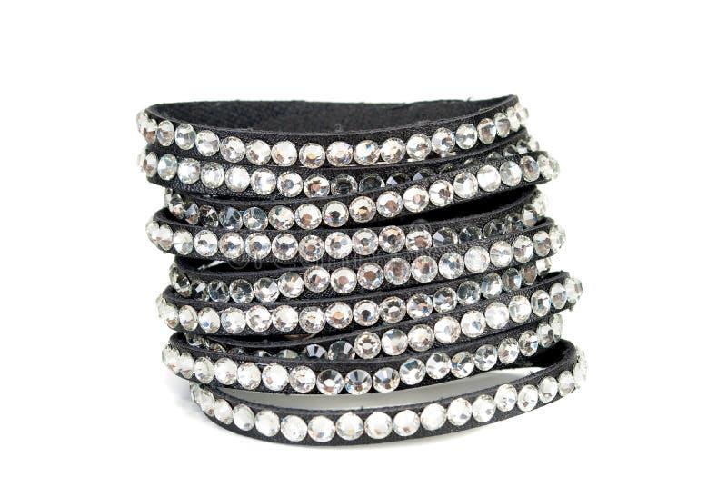 Leather bracelet. Sparkly Goth punk leather bracelet on white background closeup stock photography