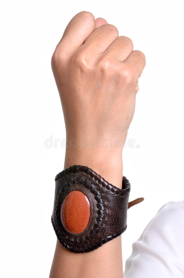 Leather bracelet. Adorned with colored stones stock photography