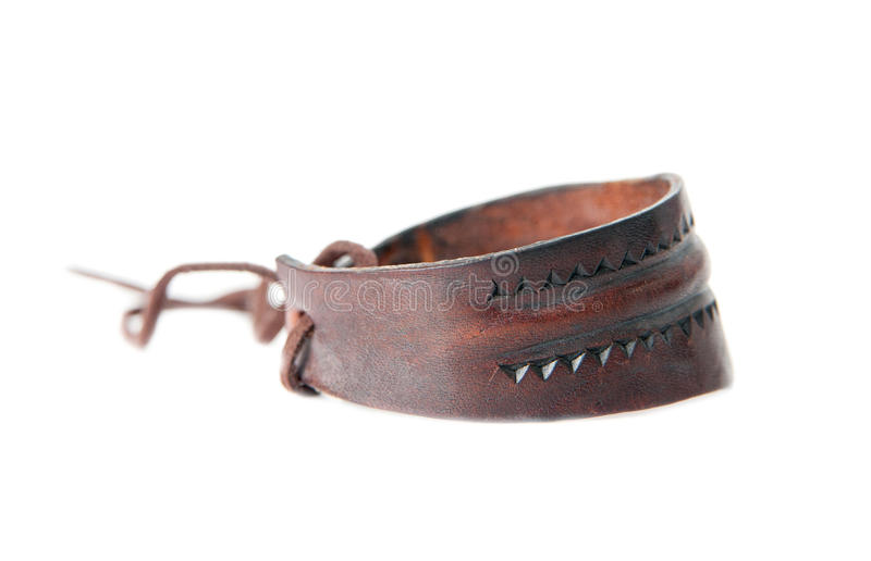 Leather bracelet. With carved motifs isolated on white stock photo