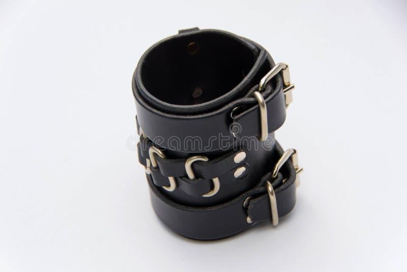 Leather bracelet on white backgrounde. Leather bracelet cuff, isolated on white backgrounde.Close up stock images