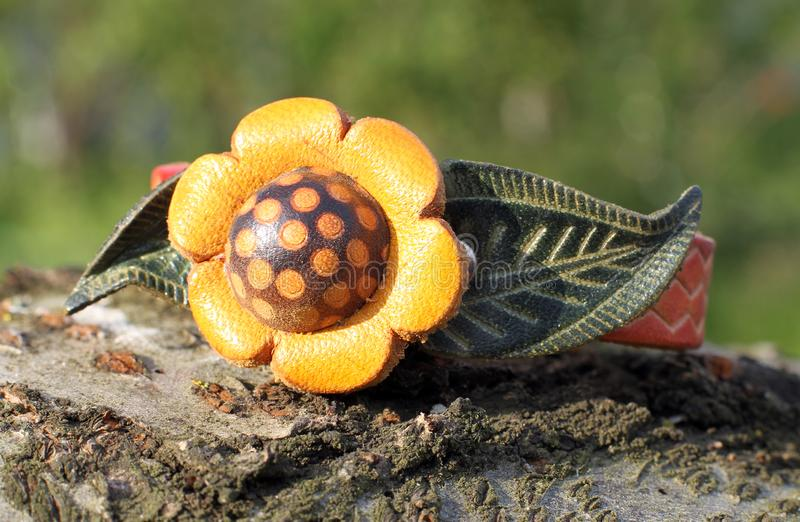 A leather bracelet with a flower hand made. A leather bracelet with a flower eco style hand made royalty free stock photography
