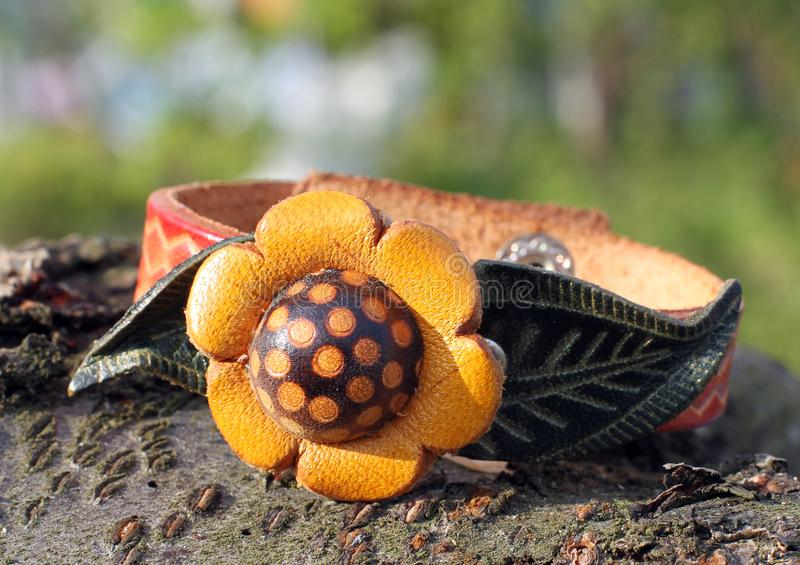 Leather bracelet with a flower hand made. Leather bracelet with a flower eco style hand made royalty free stock photos