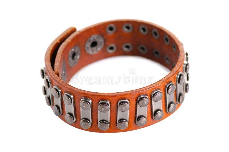 Leather bracelet rivets. On a white background isolation stock photo