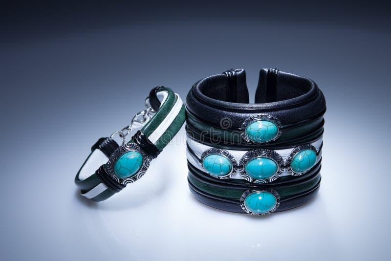 Leather bracelets with blue stones stock image
