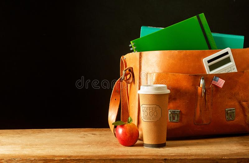 Leather briefcase satchel with coffee cup stock photo