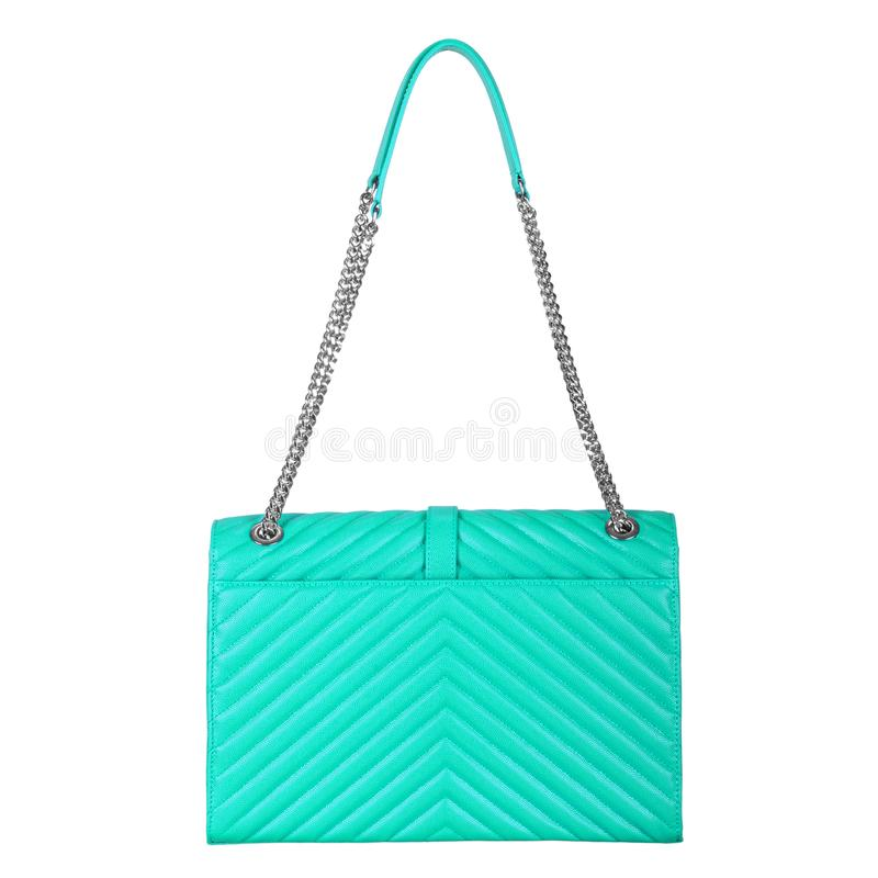Leather bright turquoise female bag with silver large chain stock photography