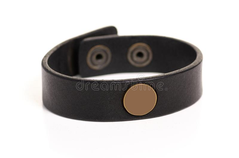 Leather brown bracelet. On white background isolation stock images