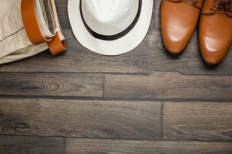 Leather brown shoes, white hat stock photo