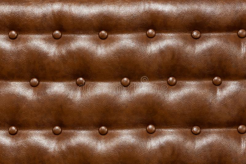 Leather brown upholstery. Brown leather upholstery sofa, space for text royalty free stock photos