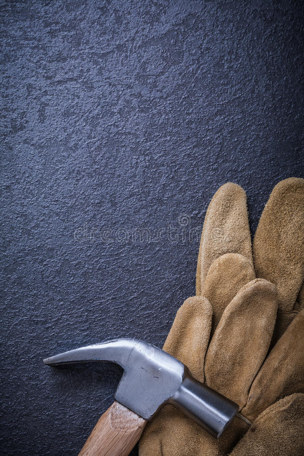 Leather brown working gloves claw hammer. Construction concept royalty free stock photos