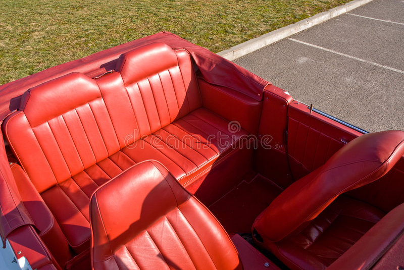 Leather car interior. Red leather car interior, old cabriolet royalty free stock photo
