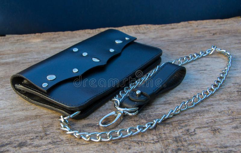 Leather chain wallet. On the wooden backgrond. - image royalty free stock photography