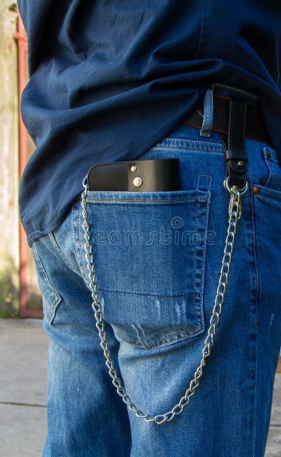 Leather chain wallet. On the wooden backgrond. - image stock images