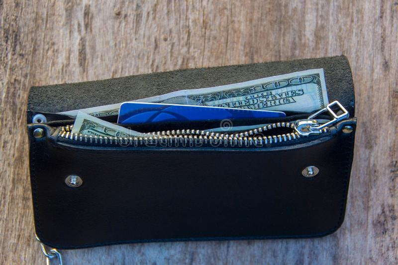 Leather chain wallet. On the wooden backgrond. - image stock photography