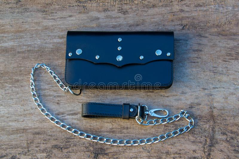 Leather chain wallet. On the wooden backgrond. - image royalty free stock image