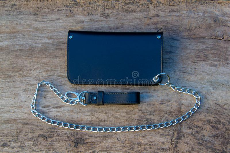 Leather chain wallet. On the wooden backgrond. - image royalty free stock photo