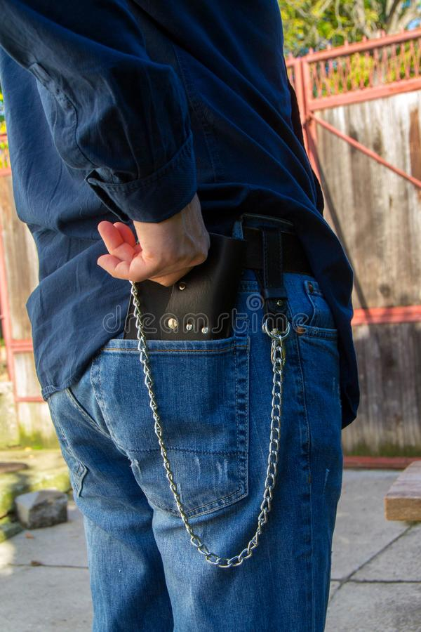 Leather chain wallet. On the wooden backgrond. - image stock photo