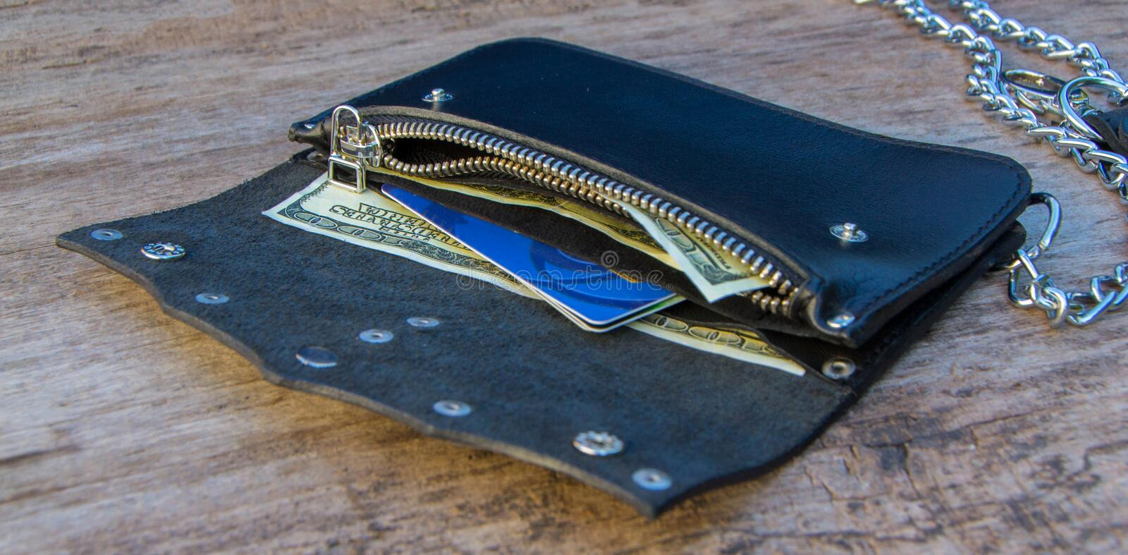 Leather chain wallet. On the wooden backgrond. - image royalty free stock photos