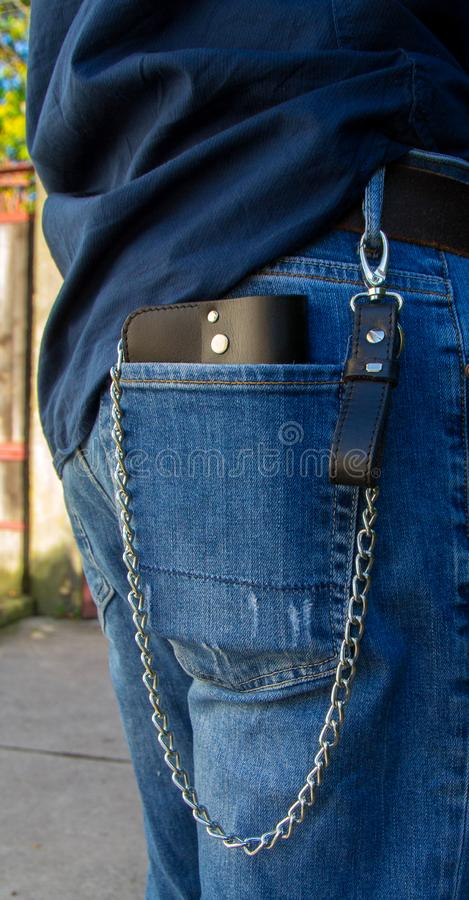 Leather chain wallet. On the wooden backgrond. - image royalty free stock images