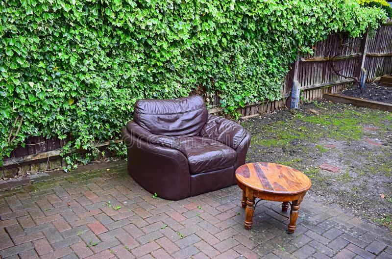 Leather Chair And Coffee Table Outside stock image