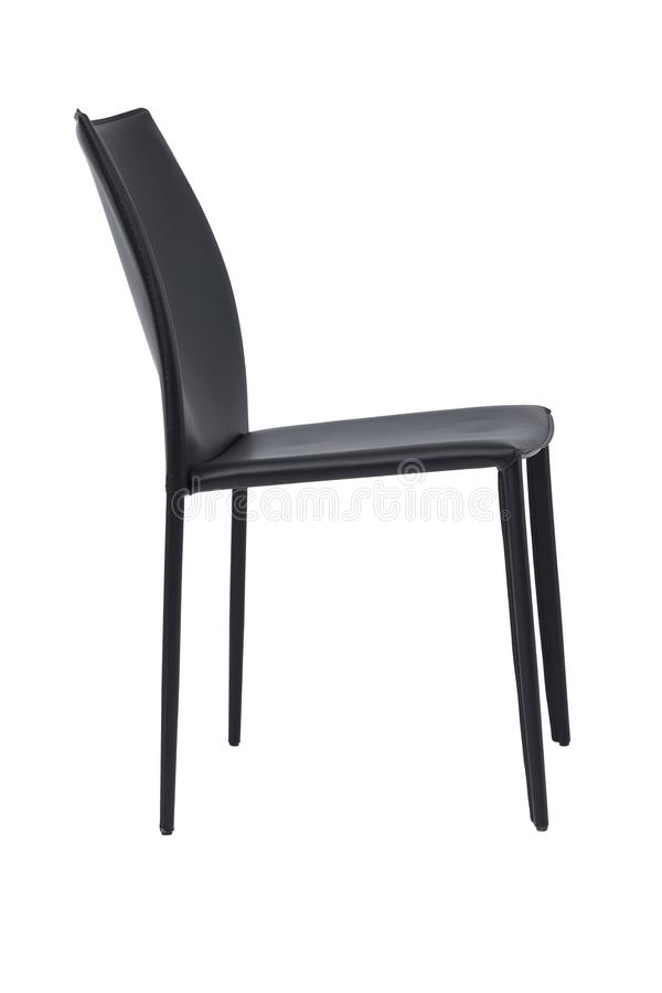 Leather chair with curved back, side view. Contemporary home furniture. Simple black chair with plastic legs isolated on white royalty free stock photo