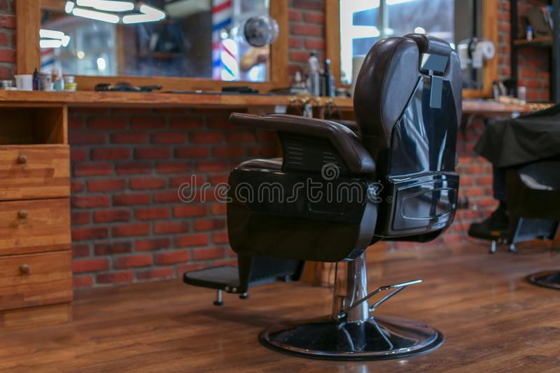 Leather chair in modern hairdressing salon royalty free stock image