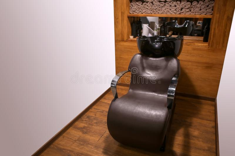 Leather chair in modern hairdressing salon stock images