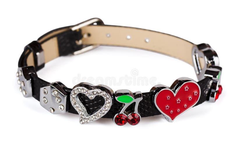 Leather charm bracelet. Black leather charm bracelet isolated on white royalty free stock photo
