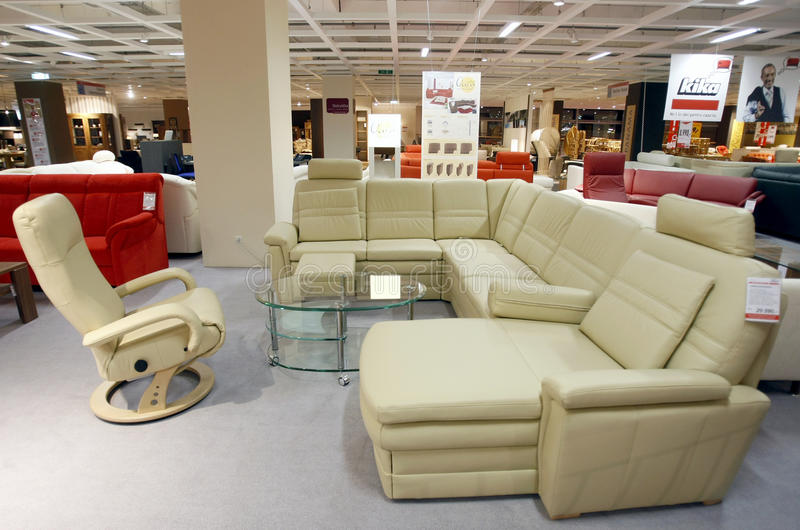 Leather couch and armchair in furniture store royalty free stock images