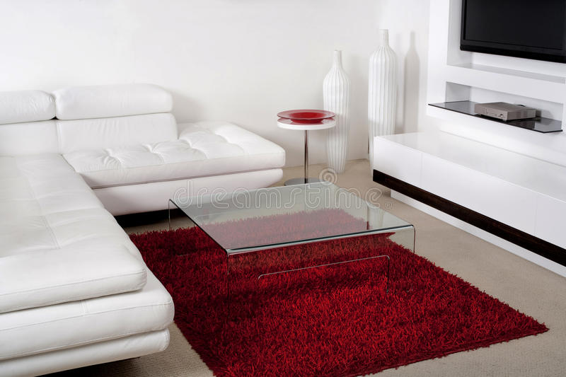 Leather couch in modern living room. White leather couch in modern living room royalty free stock photos