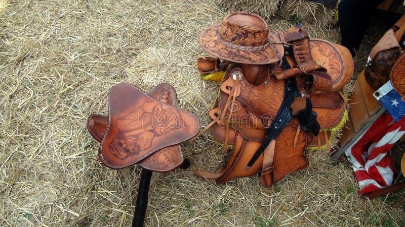 Leather Cowboy Souvenirs - Hat, Gun Belt, Chair royalty free stock photo