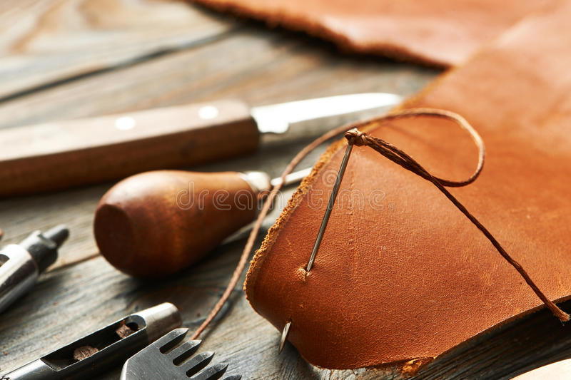 Leather crafting tools. Leather crafting DIY tools still life royalty free stock photos
