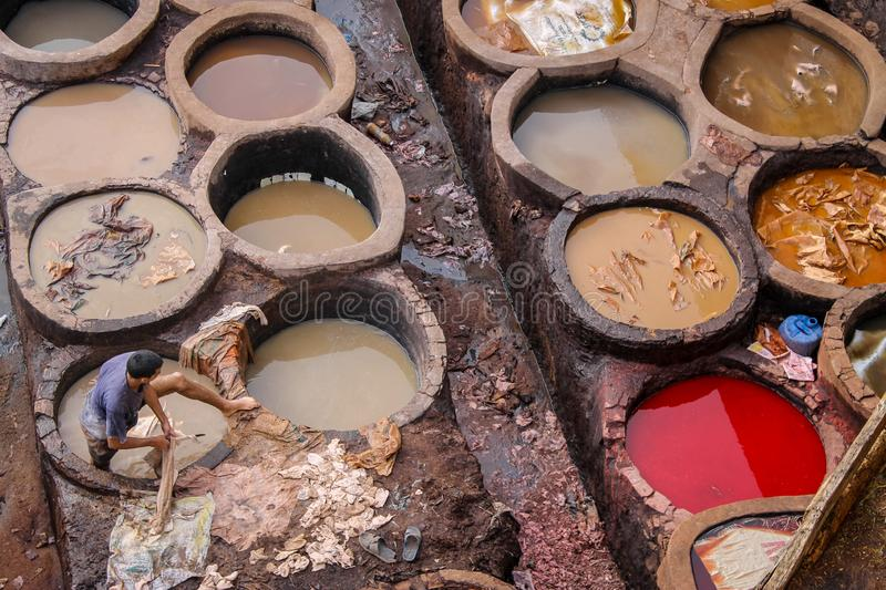 Leather dying in a traditional tannery in the city of Fez royalty free stock photo