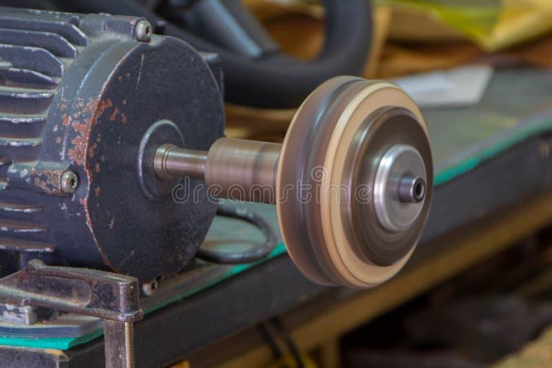 Leather edge burnisher machine. Burnisher machine at work stock photography