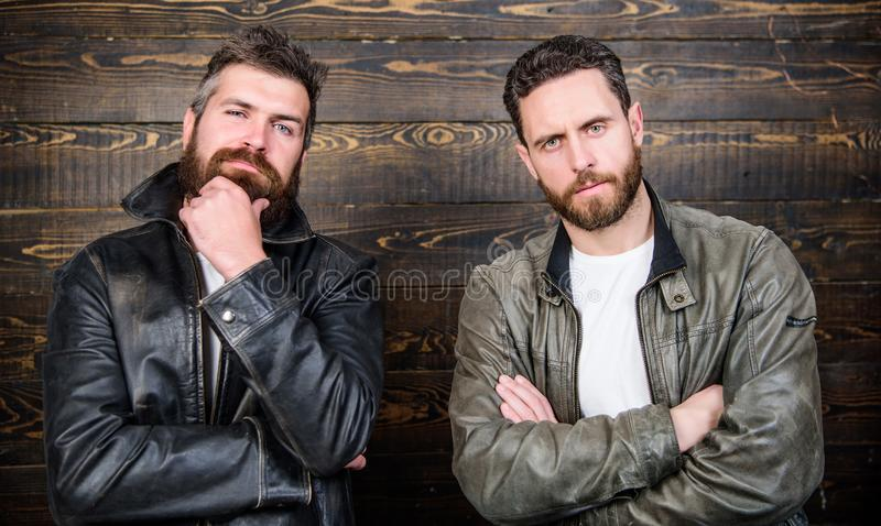 Leather fashion menswear. Handsome stylish and cool. Feel confident in brutal leather clothes. Brutal men wear leather. Jackets. Men brutal bearded hipster stock photography