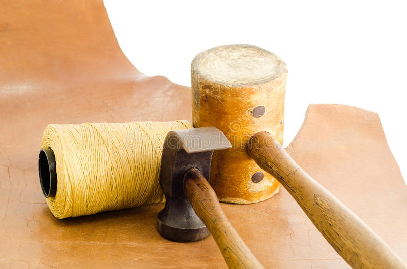 Leather hammer and hand tool for shoemaker in his workshop repairing leather shoe. stock photography
