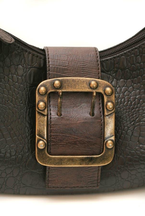 Leather handbag III. Cloesup of a leather handbag with a belt buckle royalty free stock photography
