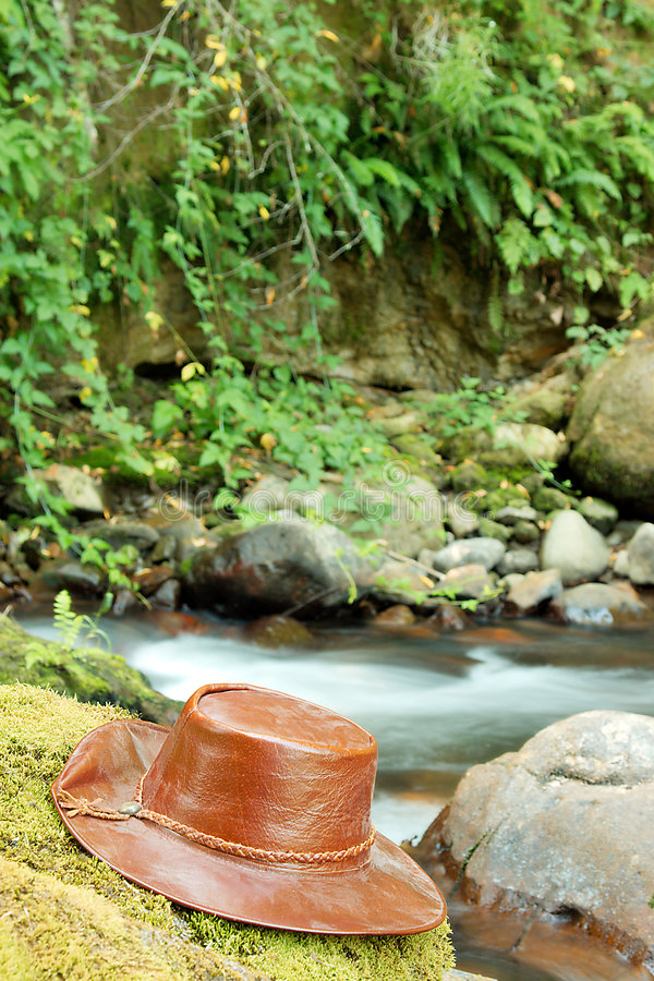 Download Leather hat next to river stock photo. Image of headwear - 6104874