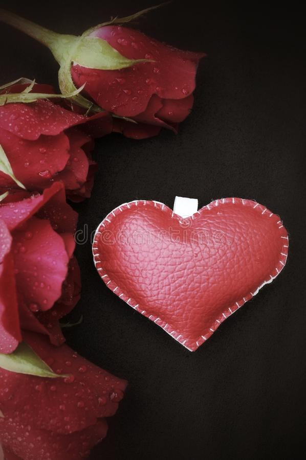 Leather heart with red roses. Leather heart with red roses for valentine day stock photo