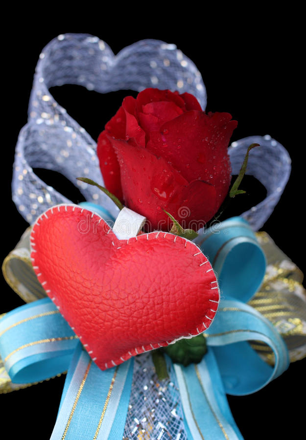 Leather heart with red roses. For valentine day stock images