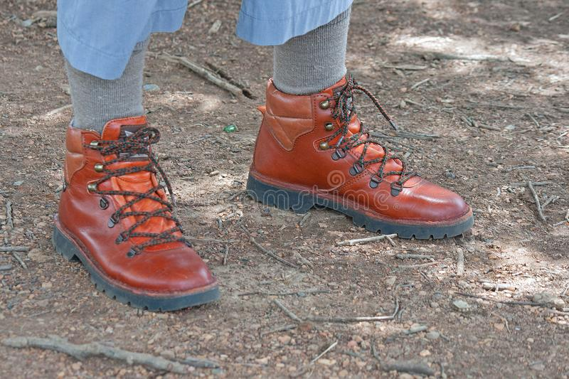LEATHER HIKING BOOTS. View of pair of hiking boots on a person`s feet royalty free stock images