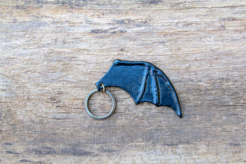 Leather key ring, bat wing. Leather key ring in the shape of bat wing. Vampire symbols stock photo