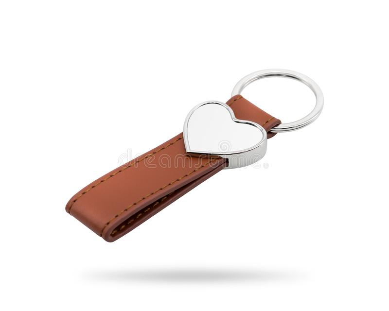 Leather key ring isolated on white background. Fashion key chain for your design. Clipping paths object. Heart shape. Leather key ring isolated on white royalty free stock image